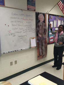 Dr. Nambiar teaching her Physics class about Einstein.